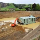Waikaia Gold's floating dredge, shortly after it was commissioned in late 2013, in Northern...
