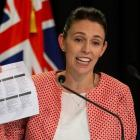 Prime Minister Jacinda Ardern holds up a NZ Trade and Enterprise list of aquifers to promote...