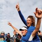 Europe players Ian Poulter (L) and Tommy Fleetwood celebrate their victory. Photo: Reuters