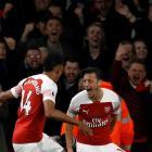 Arsenal's Pierre-Emerick Aubameyang (L) celebrates scoring their third goal with Mesut Ozil....