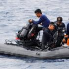 Rescue team members head to where the plane crashed, off the north coast of Karawang in West Java...
