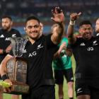 Ofa Tu'ungafasi celebrates with the Freedom Cup trophy after the match where the All Blacks beat...