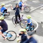 Carisbrook School pupil Ramona Mahutte (13) celebrates the opening of a new bike tracks at the...