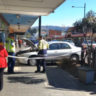A car crashed into a fence coming to a stop outside a record store in South Dunedin this morning. Screengrab: ODT