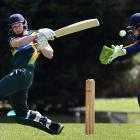 Green Island all-rounder Geordie Scott pulls the ball during a senior grade one-day game against...