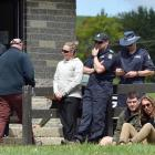 Search and rescue personnel gather at the Catlins SAR headquarters in Owaka after finding the...