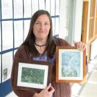 Dr Jenny Rock with two of her works, Survivor (left) and Off the Ends, in the University of Otago...
