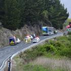 Emergency services at the scene of the crash this morning. Photo: Tracey Roxburgh