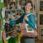 Anna van Riel with a Plastic Bag Free Wanaka upcycled, reusable bag. Photo: supplied
