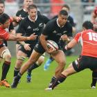 Winger Frank Halai makes a run for the All Blacks when they played Japan in 2013. Photo: Getty...