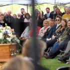 Scott Tomlinson speaks at the funeral of his wife, Nadine, and son, Angus (3), at Flaxes Retreat...