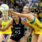 Courtney Bruce of the Australian Diamonds and Aliyah Dunn of the New Zealand Silver Ferns...