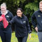 Prince Harry, Duke of Sussex watches as his wife Meghan, Duchess of Sussex takes part in the...
