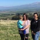 Hakataramea Sustainability Collective members Sarah Elliot holding Gus (3), and Juliet Gray, who...