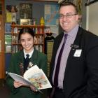 Columba College pupil Georgia Wong receives a prize from New Zealand Holocaust Centre director...