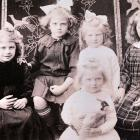 The Holt sisters (from left) Ruby, Phyllis, Edna and Isy, with Nellie in front.