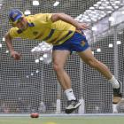 Otago top-order batsman Josh Tasman-Jones flings the ball towards the stumps during a training...