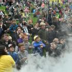 """Children react to smoke during a """"science of rainbows'' display by Amadeo Enriquez Ballestero, of..."""