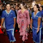 Meghan, Duchess of Sussex, walks with locals during a visit to a market in Suva, Fiji. Photo:...