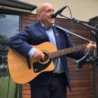 Central Otago Mayor Tim Cadogan sings the opening number at the inaugural Alexandra Buskers...