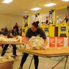 Reigning national woolhandling champion Joel Henare (at centre table) from Gisborne/Motueka made...