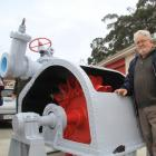 Oamaru heritage engineering advocate Bruce Comfort with an original Pelton wheel turbine which he...