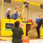 Jack Fagan switches on the shearing machine for his father, Sir David Fagan, halfway through the...