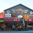 The old-fashioned decor and motoring memorabilia draw visitors to Rick's Garage, in Palmwoods,...