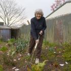 Pat Scott in her garden.