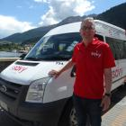 Go Bus director Russell Turnbull with a Savy ride-share minibus in Queenstown last November....