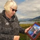 Janet Rutherford with a photo of her late husband, Robert, at her Frankton home yesterday. PHOTO:...