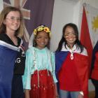 Pupils Sylvia Niccol (12), Kate Ardiente (12), and Mary Navasca (13) run the New Zealand stall at...