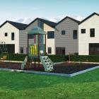 An artist's's impression shows four two-storey townhouses planned for a commercial site at...