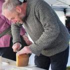 Cheesemonger Martin Aspinwall, of Canterbury Cheesemongers, cuts cheese at last year's amateur...