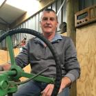 Gordon Handy at the wheel of a 1937 John Deere tractor once owned by his grandfather. Photo:...