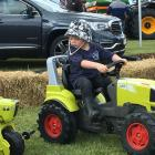 Jaxon Dole (3), of Ashburton, takes the Claas Arion for a test drive at the Ashburton A&P...