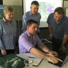 Explaining the benefits of Satellite Imagery to Mid Canterbury farmer Chris Ford, of Ashburton...