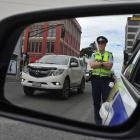Sergeant Blair Dalton, of Dunedin, watches the traffic on Cumberland St yesterday. PHOTO: GREGOR...