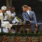 Britain's Prince Harry and Meghan, the Duchess of Sussex attend an official welcome ceremony in...