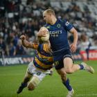 Mitchell Karpik tries in vain to catch him during a Mitre 10 Cup match at Forsyth Barr Stadium in...