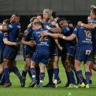 Otago players celebrate beating Hawke's Bay in their Mitre 10 Cup semifinal at Forsyth Barr...