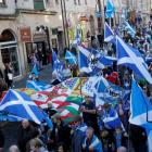 The campaigners waved giant blue Scotland flags and sported kilts as they congregated in a park...