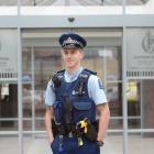 Probationary constable Scott Turner outside the Dunedin Police Station yesterday.PHOTO: LINDA...