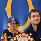 Hayden Symister (8), of Dunedin, and Otago captain Michael Collins with the Ranfurly Shield at...