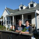 South Dunedin Community Network members Eleanor Doig (left) and Emma-Kate Lamb outside Eleanor's...