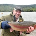 Otago Fish & Game Council field officer and hatchery manager Steve Dixon prepares to release...