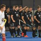 Kane Russell, of New Zealand, celebrates with team mates after scoring his side's first goal...
