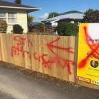 The homeowner wasn't able to get the graffiti off the fence. Photos: Supplied via NZ Herald