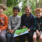 Pine Hill School pupils (from left) Hunter Burgess (11), Yazan Al Hassan (8), Summer Hotton (10)...