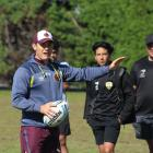 Brisbane Broncos game development manager and Broncos women's coach Paul Dyer put a group of...